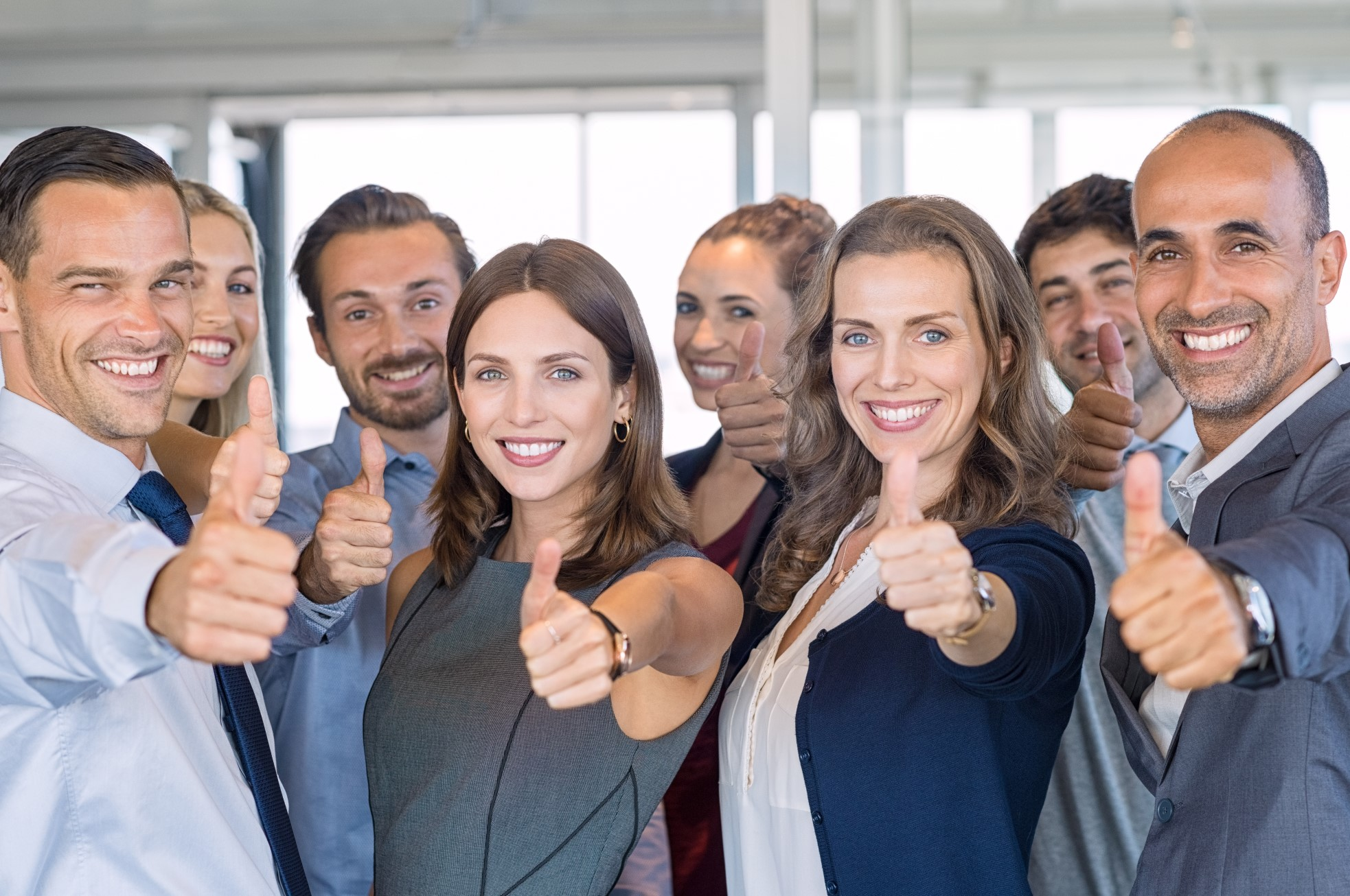 Group of happy business people showing sign of success.