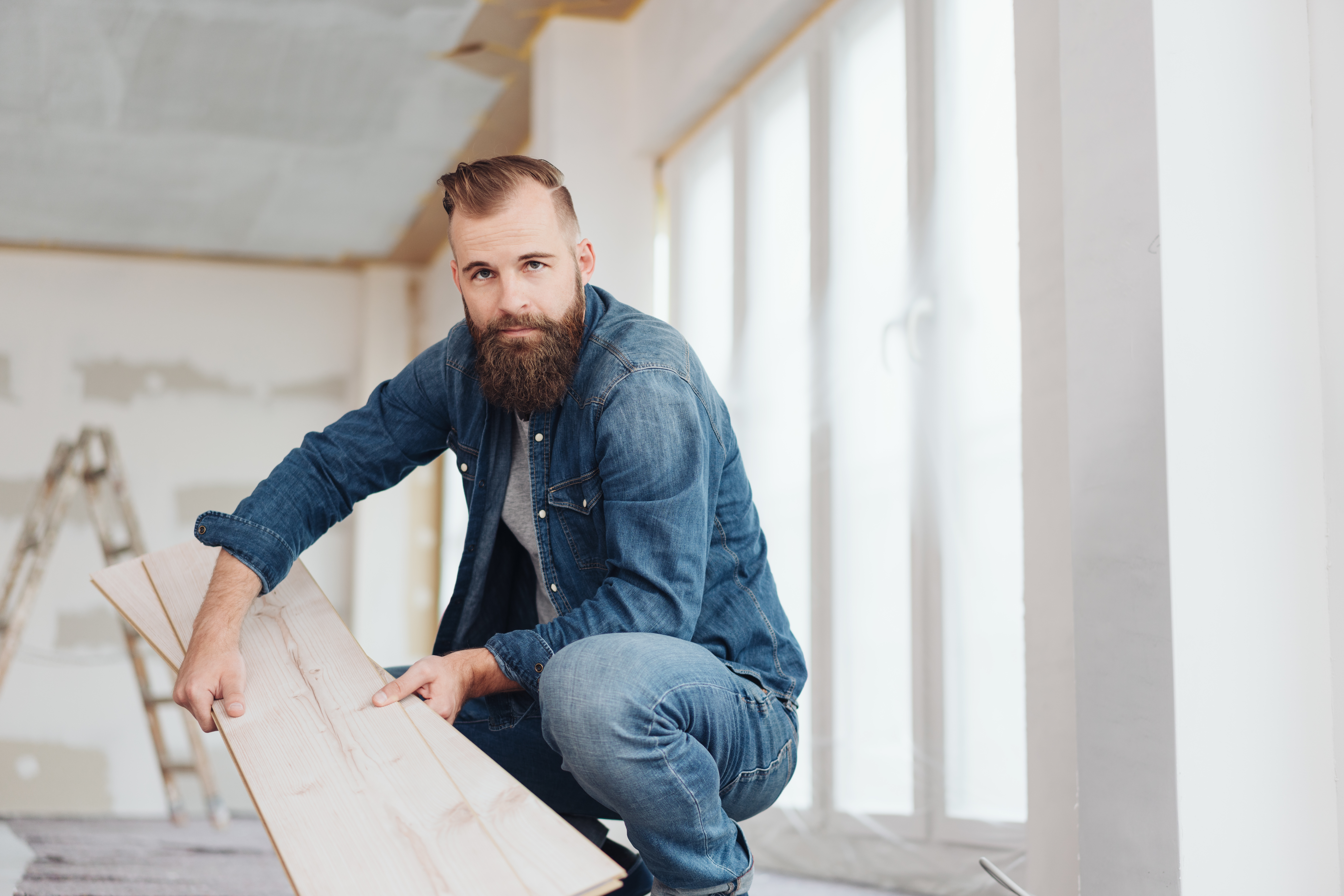 Serious bearded young man doing DIY renovations